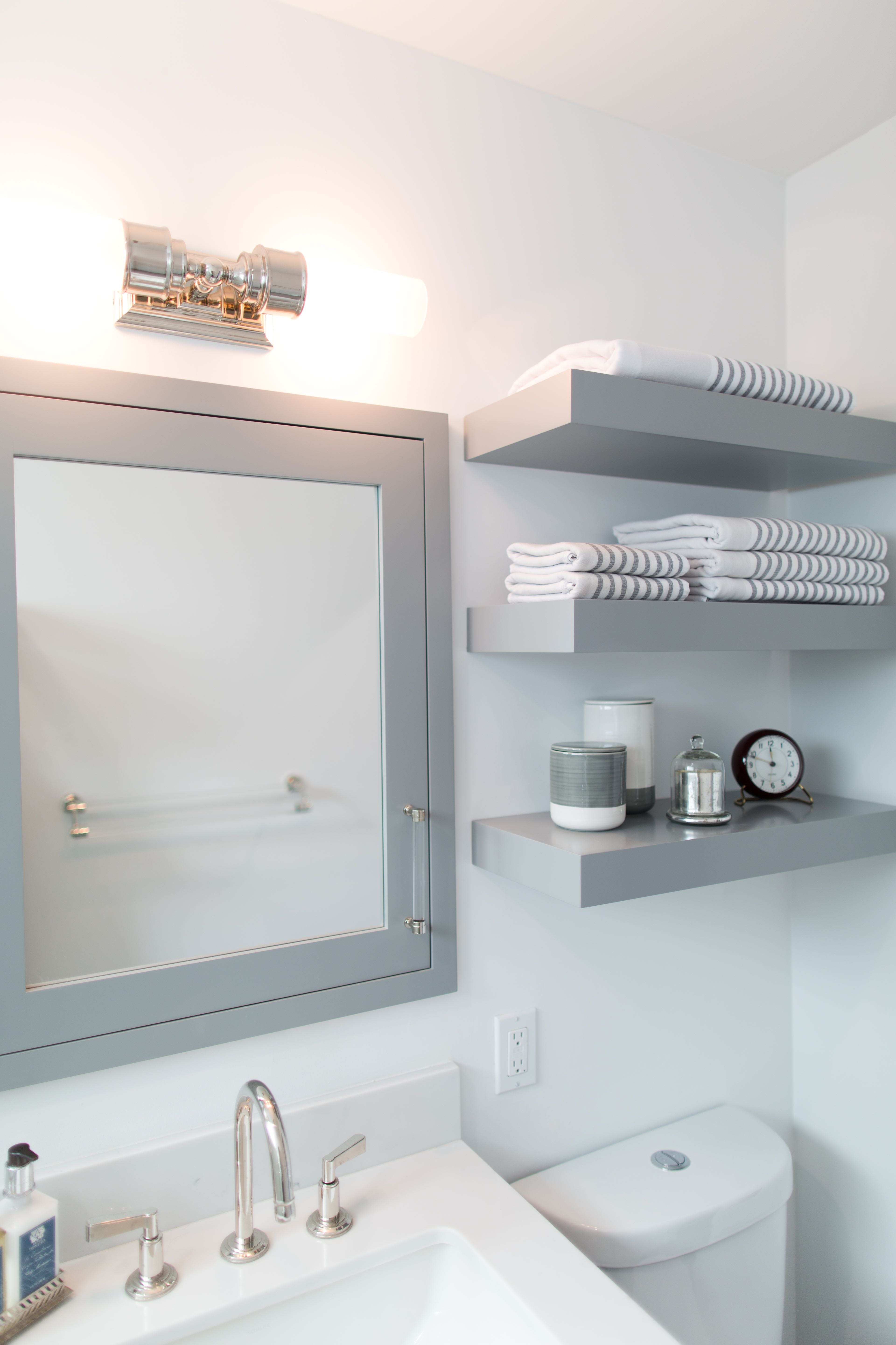 Custom Vanity With Storage Built Into The Medicine Cabinet And Floating Shelving For Storage And Display Kuzak S Closet